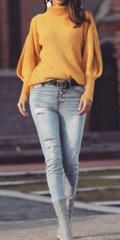 Fall in love this winter season with these cozy sweater outfits. Winter Fashion via higiggle.com   Long sleeved yellow sweater   #sweater #winter #fashion #knit