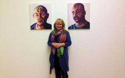 Christie Buckingham with portraits of Andrew Chan, left, and Myuran Sukumaran.