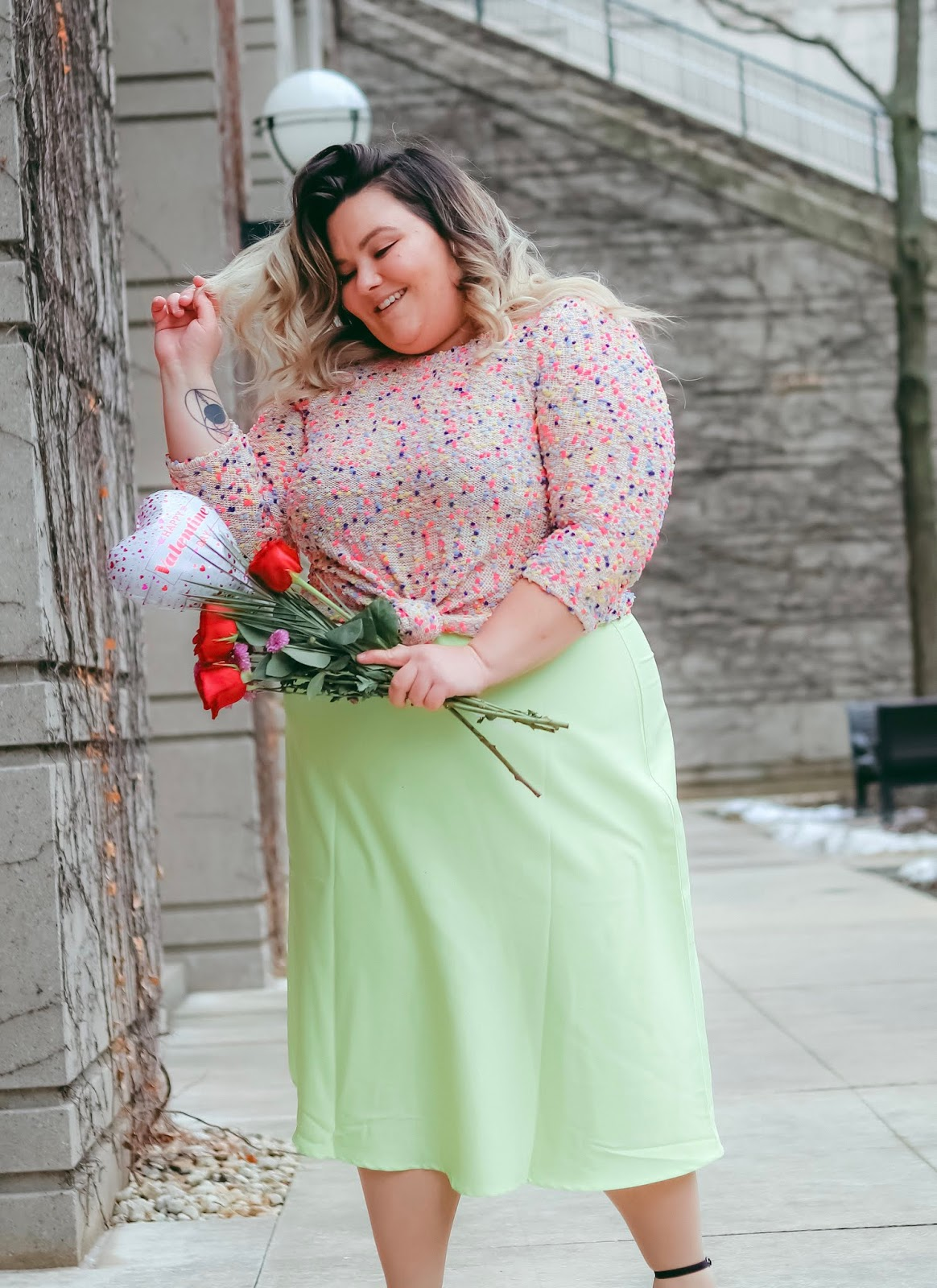 Chicago Plus Size Petite Fashion Blogger, influencer, YouTuber, and model Natalie Craig, of Natalie in the City, reviews Eloquii's satin midi slip skirt and Gordmans' sweaters.