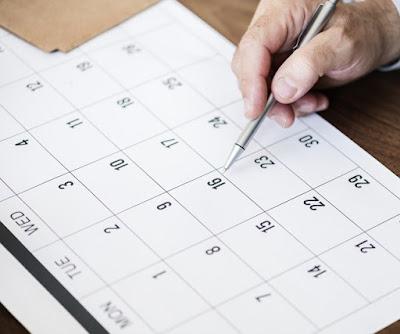 blank calendar and pen