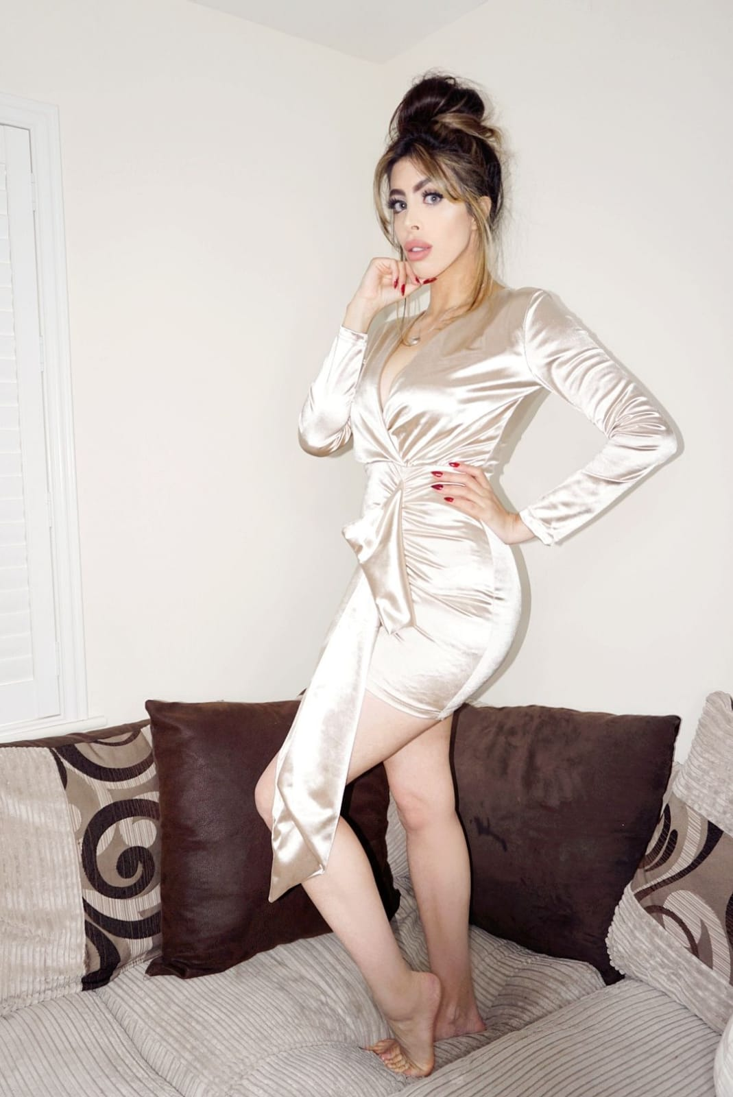 The Femme Luxe Gold Bodycon Side Detail Mini Dress in model Joanna