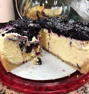 Keto Cheesecake Topped With A blueberry compote.