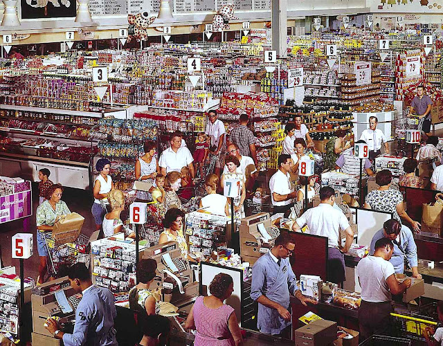 A vintage supermarket color photo of busy people
