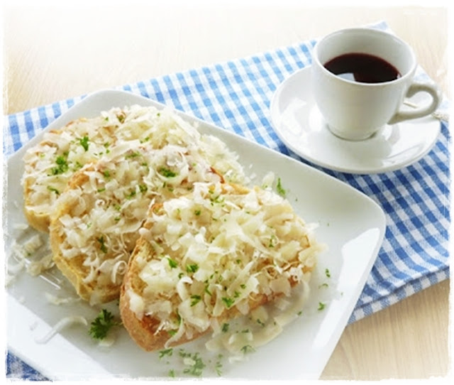 shredded Parmesan on toast