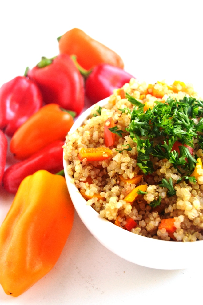 This Quinoa Bell Pepper Pilaf is a simple side dish that has toasted quinoa, sweet peppers and garlic. It can be served hot, cold or room temperature! www.nutritionistreviews.com