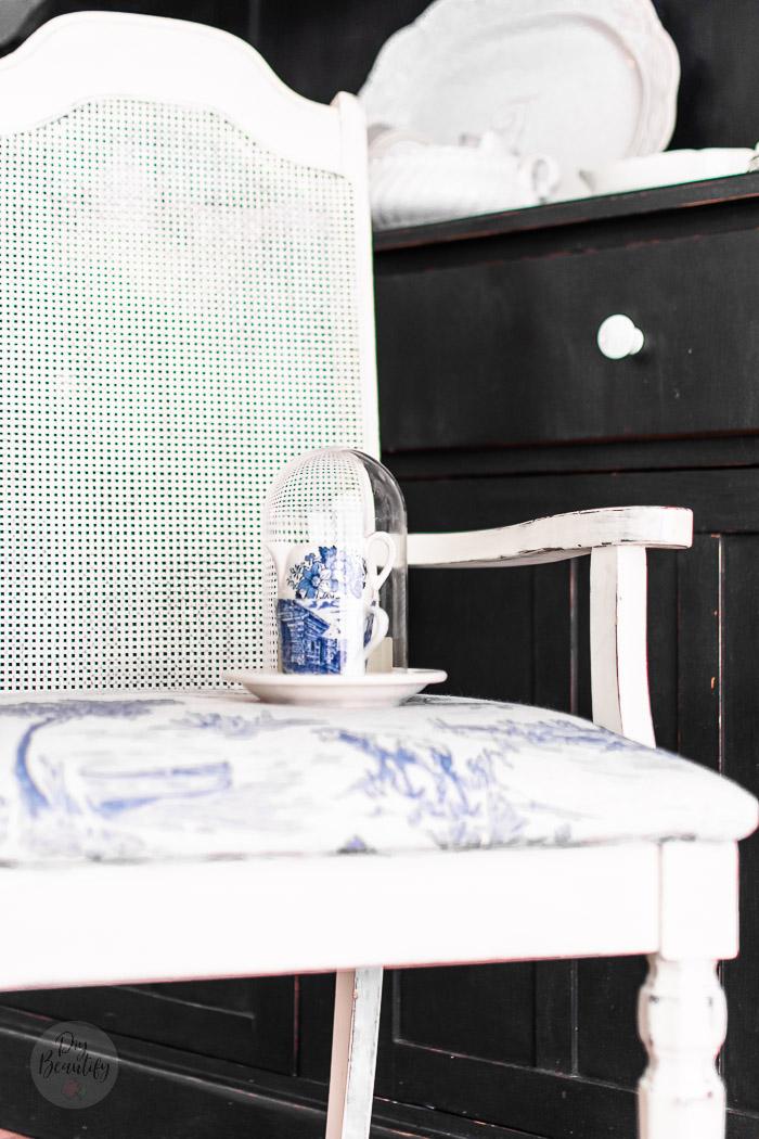 white chair with blue toile seats and mini cloche with mini blue transferware creamers