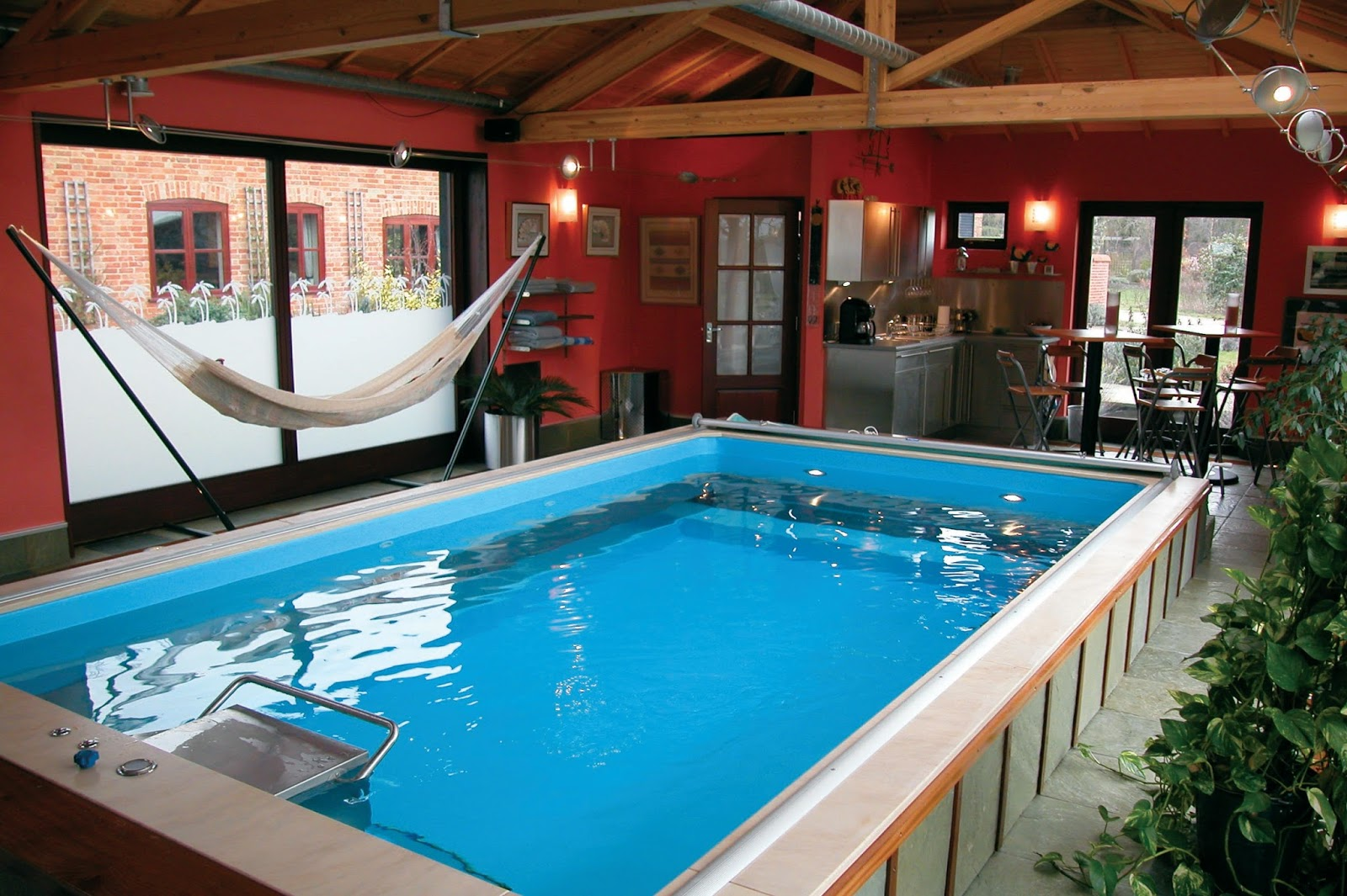 Pool with current to swim against - Man Cave With Hammock Kitchenette And Partially Inground Endless Pools Swimming Machine