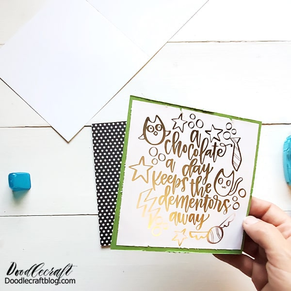 Rough up the edges of the cardstock and tape it onto a patterned piece of paper.