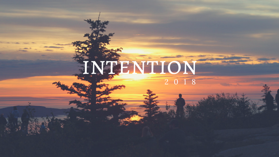 "sunrise over cadillac mountain with words ""intention 2018"" overlaid"