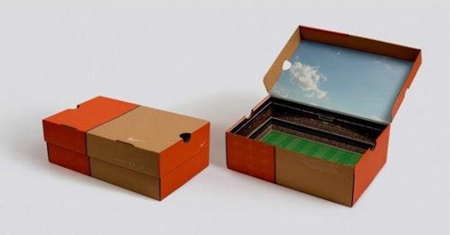 caixa criativa da nike com desenho de campo de futebol