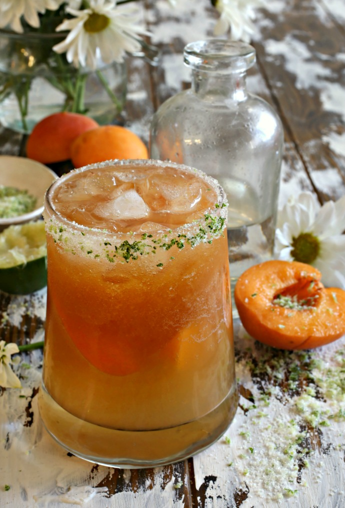 Recipe for a bourbon cocktail with fresh muddled apricots, lime juice and elderflower liqueur.