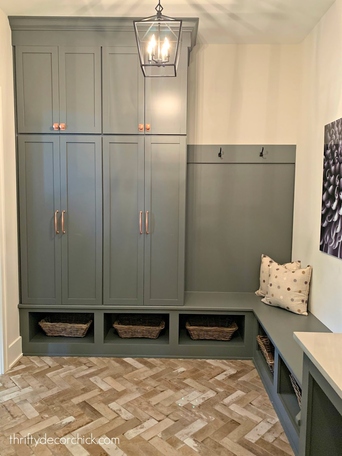 Gray cabinets brick floor mud room