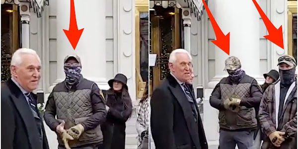 Roger Stone surrounded by far-right Oath Keepers