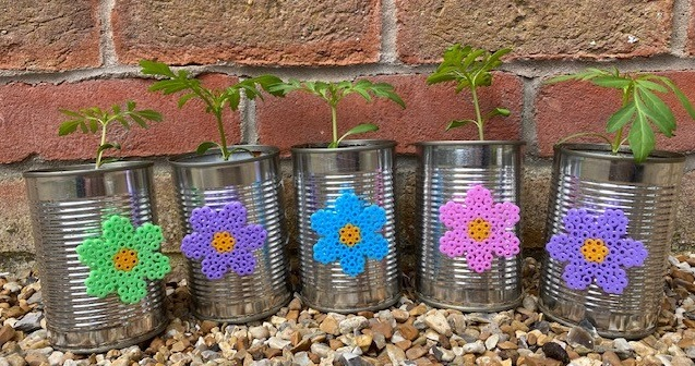 Tin can flower pots upcycled with Hama bead flower decorations
