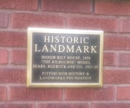 black and brass metal plaque on exterior of building, Pittsburgh History & Landmarks foundation historic landmarks plaque