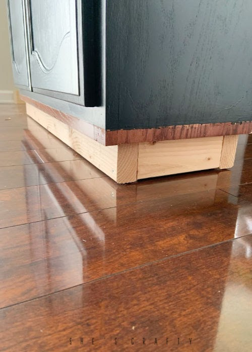 Instructions for making a sideboard buffet from a kitchen cabinet - use 2 x 4's to make a base