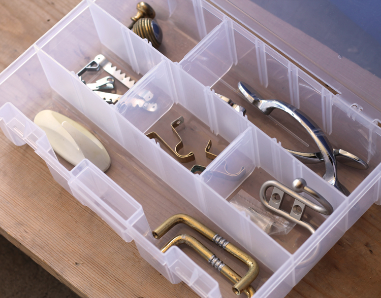 Use a plastic craft storage box to sort hardware.