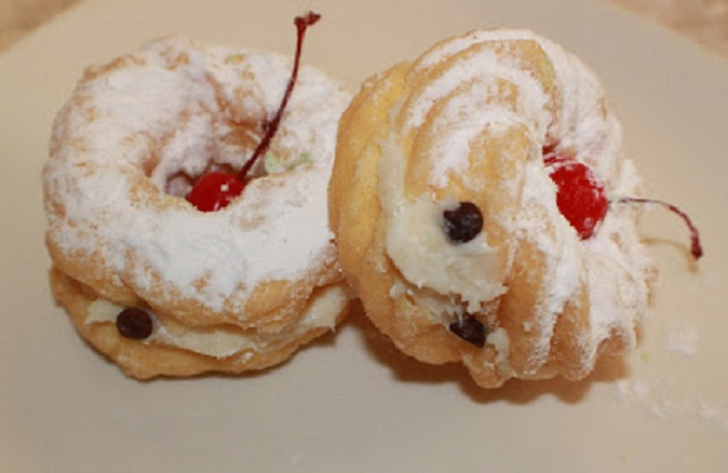 these are pastries to celebrate St. Joseph's Day made with ricotta filling and cream puff dough