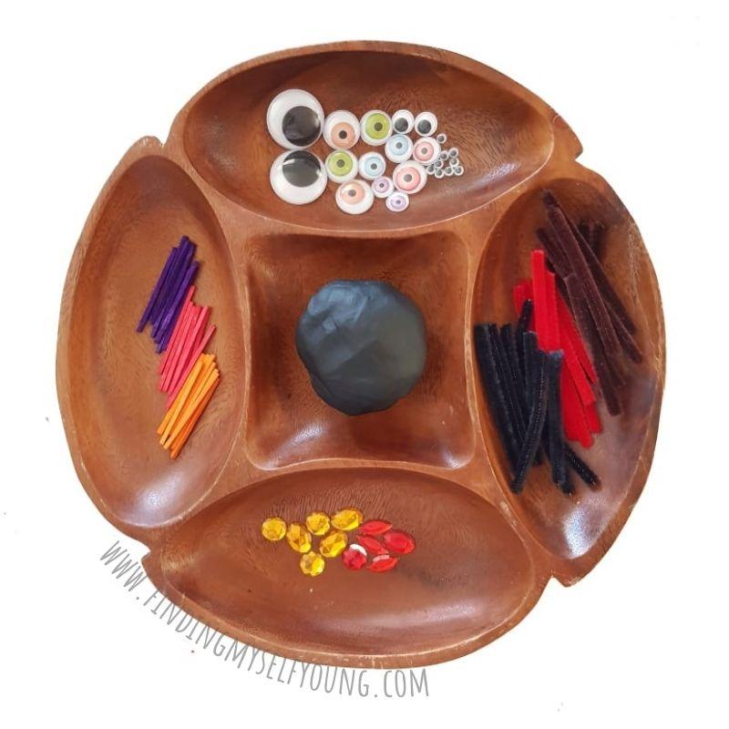 playdough tray - invitation to build a spider