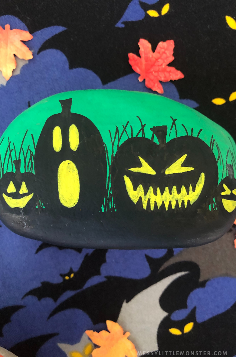 Halloween rock painting - pumpkins and jack o lanterns