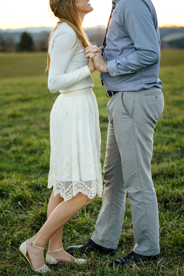 Couple field holding hands poses