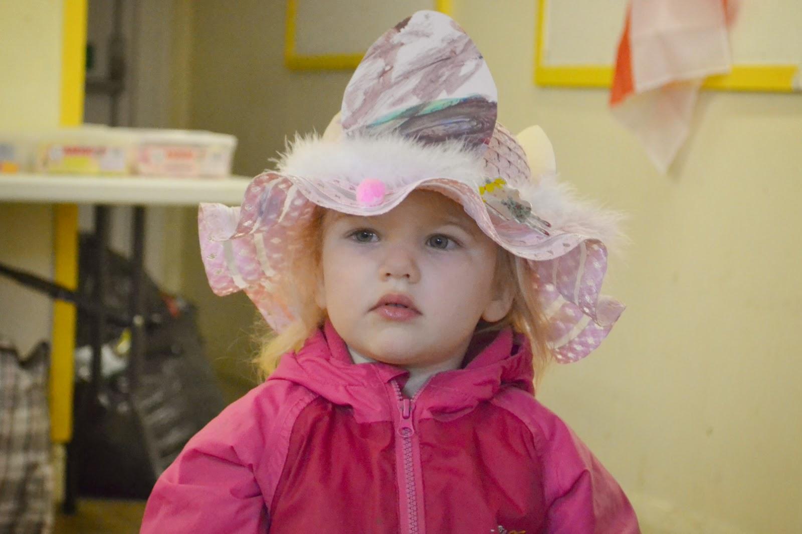 Tin Box Tot wearing an Easter bonnet