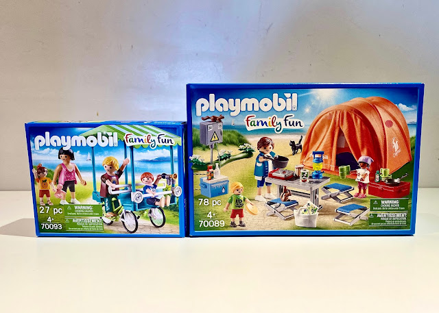 The packaging of the PLAYMOBIL Family Fun 70093 and 70089 camping and family bicycle sets being reviewed