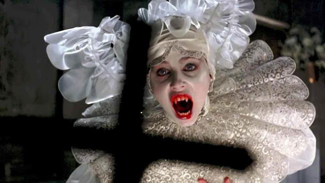 Lucy (Sadie Frost) in the vampire bride costume