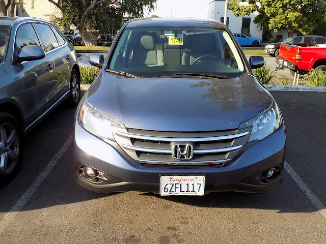 2013 Honda CR-V with repainted bumper and new fog lights at Almost Everything Auto Body.