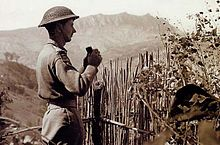 A British soldier observing German  positions at the Battle of San Marino