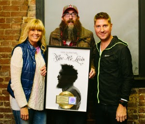 David Crowder is honored with gold certification plaque.