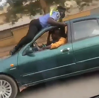 Police officer lays on the roof of a moving cab in his plan to stop the cab driver (video)