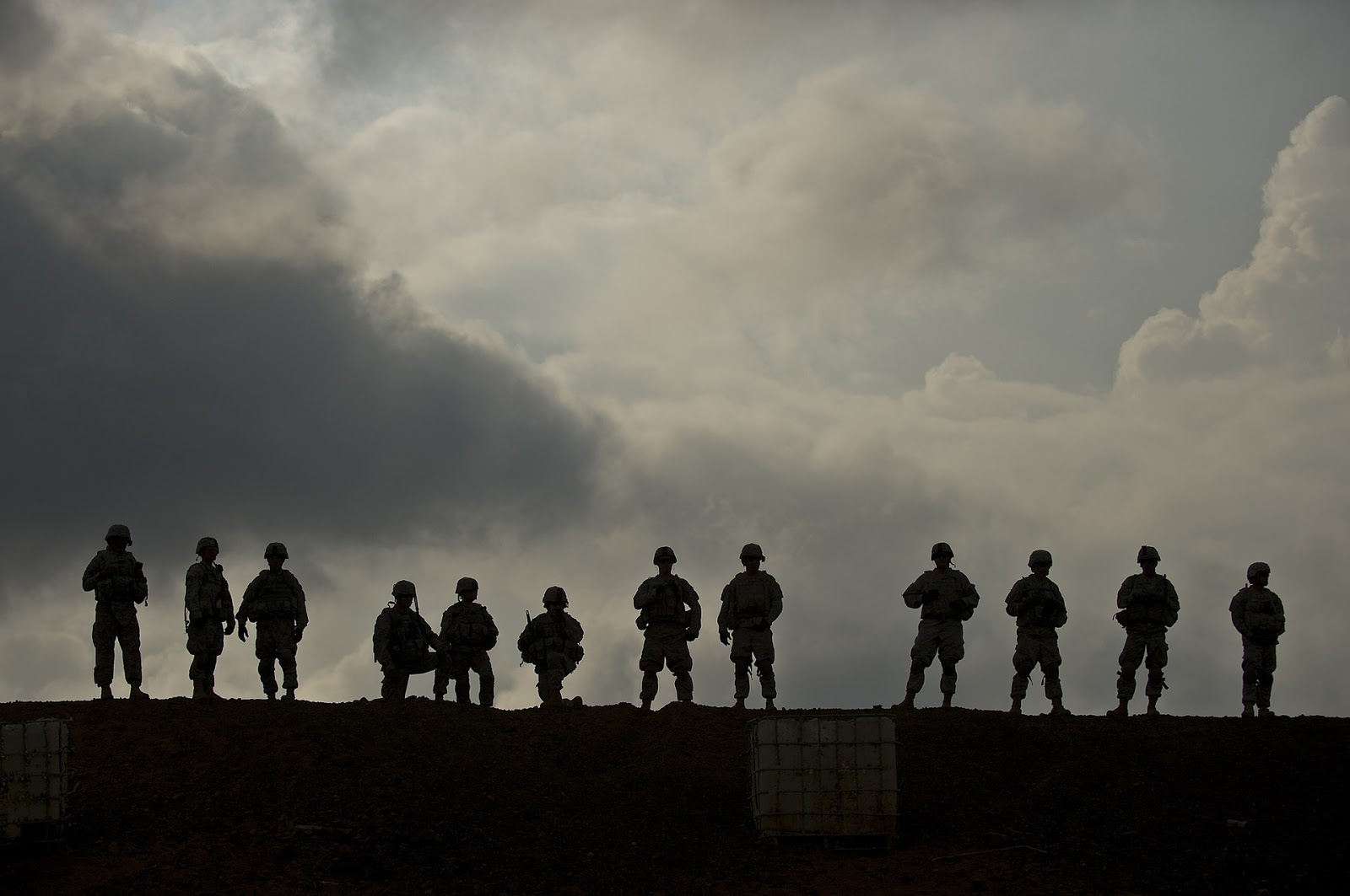 a row of soldiers standing on a hill silhouetted by a clowdy sky to illustrate a blog post about the mini-series band of brothers