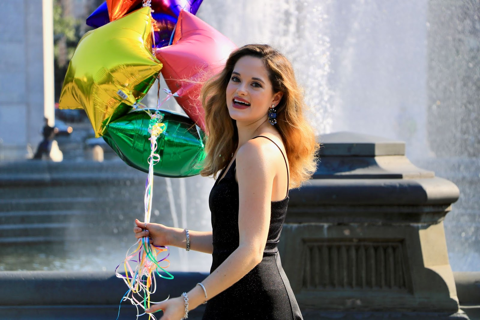 Nyc fashion blogger Kathleen Harper sharing how to take cute photos with balloons.