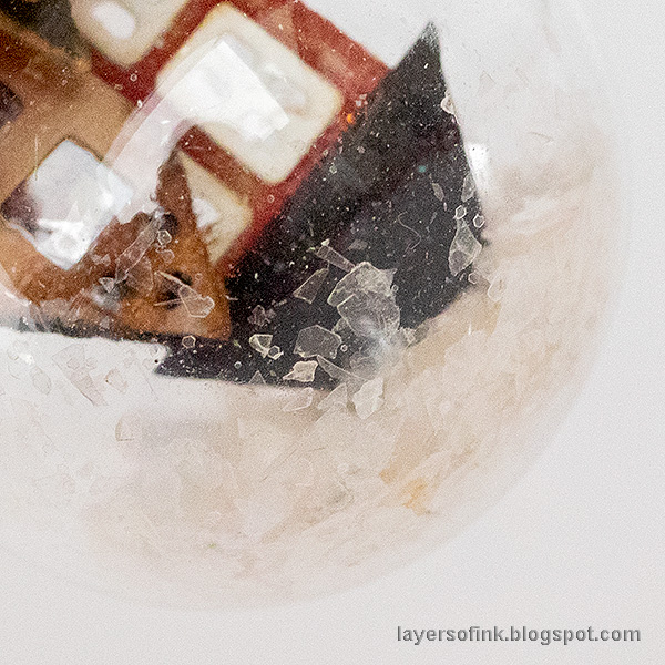 Layers of ink - Winter Cottage in a Snowglobe by Anna-Karin Evaldsson. Pour mica flakes into the snowglobe.