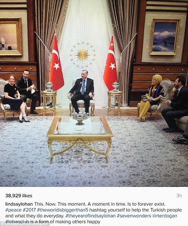 Lohan followed up with a photo of her with a group including President Erdogan and his wife in the president's lavish 1,150-room complex on the outskirts of Ankara