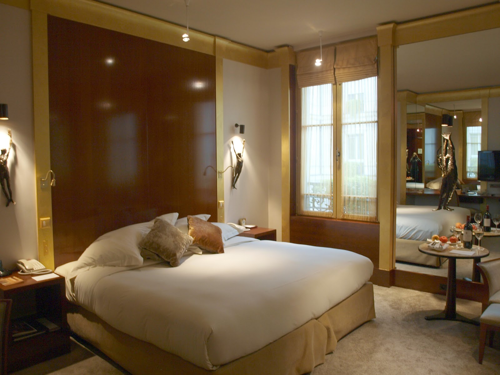 Hotel suite with mahogany wall and gold trim in Park Hyatt Paris by Hello Lovely Studio