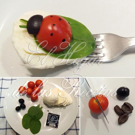 Mariquitas hechas con tomates cherry y aceitunas negras, sobre una hoja de canónigo y morzzarella