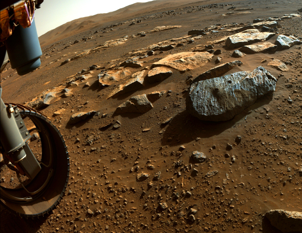 One of Perseverance's wheels is visible near the rock, nicknamed 'Rochette,' that the Mars rover extracted two core samples from...on September 1 and September 7, 2021, respectively.