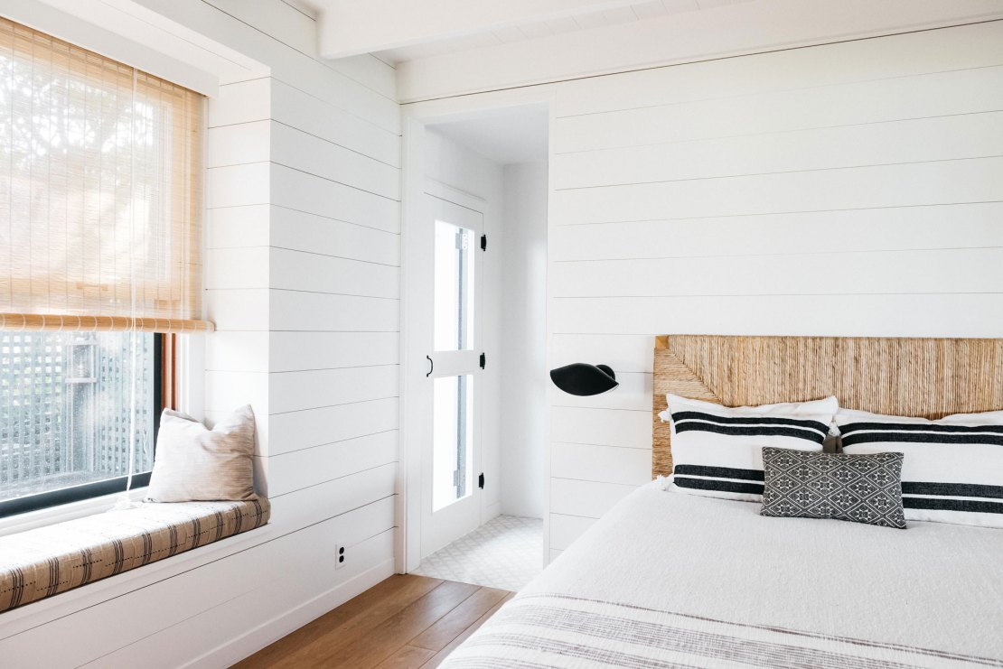 Minimal modern white bedroom with shiplap and window seat in Maui beach house - seen on Hello Lovely Studio