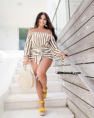 Dolly Castro coming down the stairs
