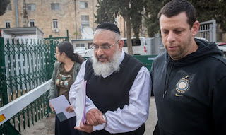 Police escort Rabbi Aharon Ramati for court hearing