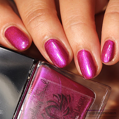 Nail polish swatch of Winterberry by Soothing Soul Nail Lacquer is a berry mauve shimmer polish