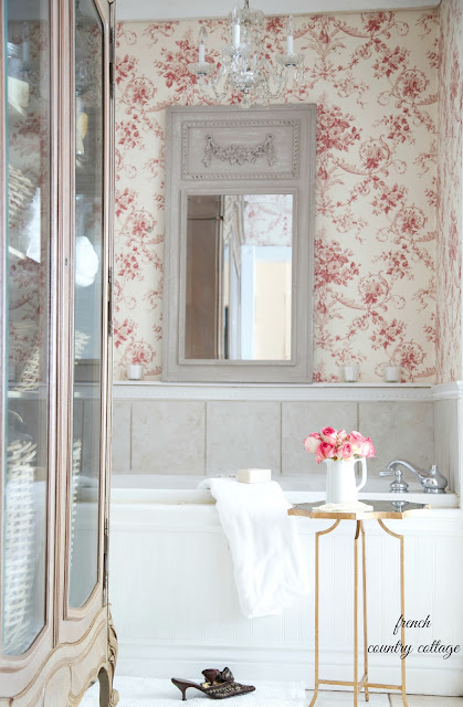 french bathroom with wallpaper