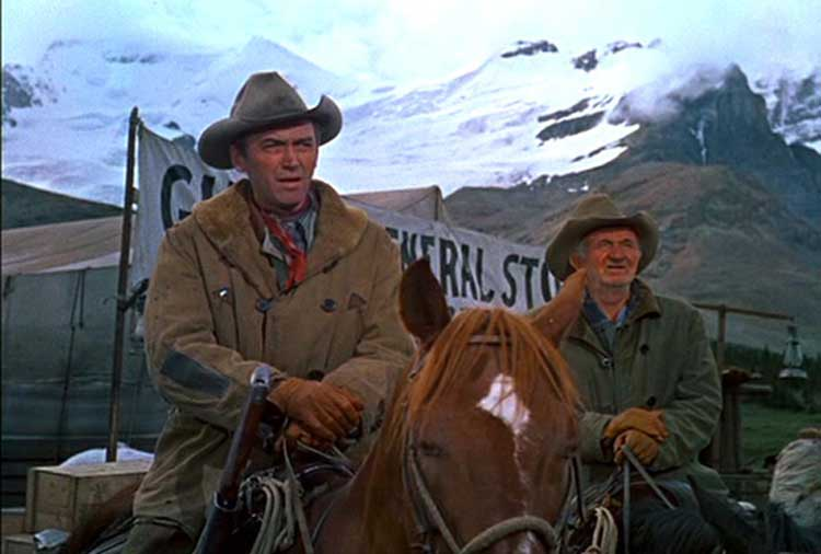 Jimmy Stewart and Walter Brennan star in The Far Country.