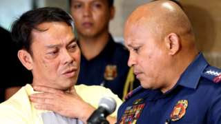 Mayor Espinosa (L) surrendered to police in August