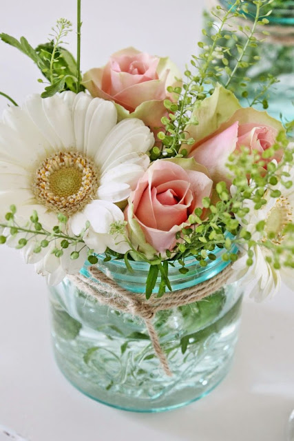 blue tinted Mason jar centerpiece
