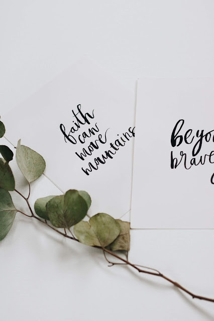 Flower laid next to motivational cards