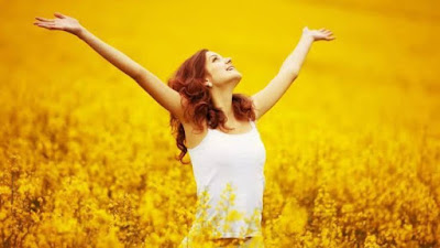 the woman who was happy, raised her hand up on the beautiful grass