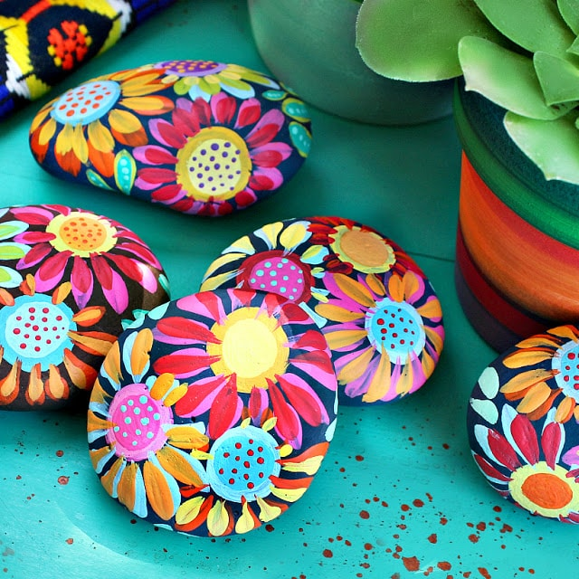 easy rock painting ideas for newbies - Mexican inspired flower rock painting design